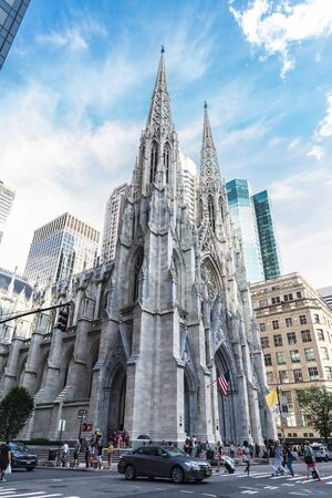New York City, USA - July 28, 2018: Facade of The Cathedral of St. Patrick on Fifth Avenue (5th Avenue) with people around in Midtown Manhattan, New York City, USA