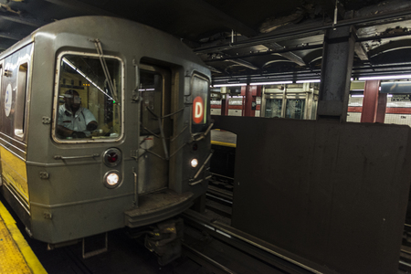 Train car in motion with its driver in a subway station of New York City, USA Redakční
