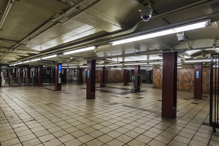 Automatic access control ticket barriers in subway station with security cameras in New York City, USA