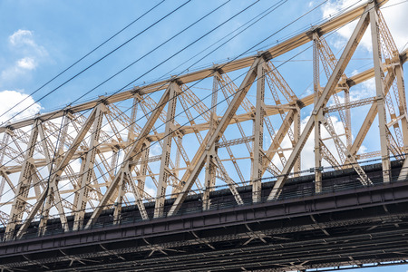 Low angle view of the Ed Koch Queensboro Bridge, also known as the 59th Street Bridge, in New York City, USA