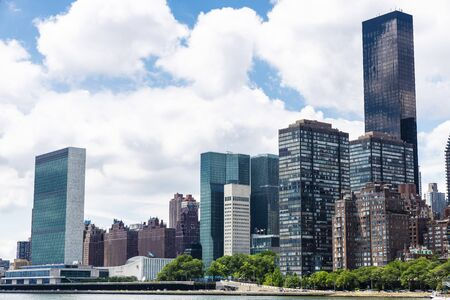 East River, the headquarters of the United Nations (UN) and the Manhattan skyline as seen from Roosevelt Island in New York City, USA