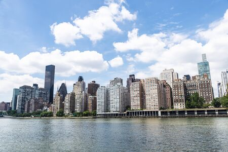 East River and the Manhattan skyline as seen from Roosevelt Island in New York City, USA