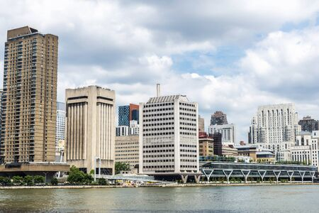 East River and the Upper East Side skyline as seen from Roosevelt Island in New York City, USA