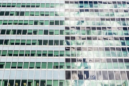 Facade of a skyscraper as background in Manhattan, New York City, USA