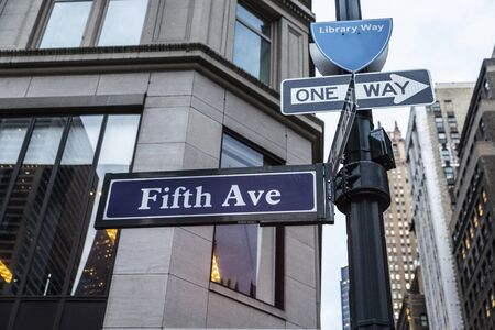 Sign of the 5th Avenue (Fifth Avenue) with modern skyscrapers in Manhattan, New York City, USA