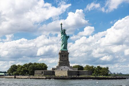 View of the Statue of Liberty with people around in New York City, USA 写真素材