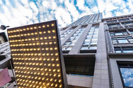 Low-angle shot of a modern glass skyscraper in Manhattan, New York City, USA