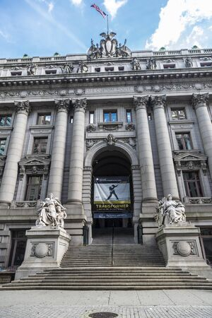 New York City, USA - August 1, 2018: Facade of the Alexander Hamilton U.S. Custom House in Manhattan, New York City, USA. The building is now the National Museum of the American Indian