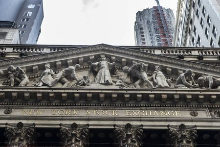 Facade of the Headquarters of New York Stock Exchange (NYSE, nicknamed The Big Board) in Wall Street, Lower Manhattan, New York City, USA.