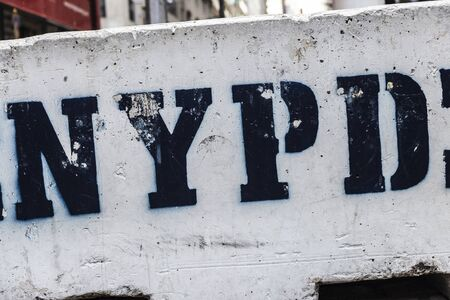 Sign of the NYPD on a concrete block as an element of security against terrorism in Manhattan, New York City, USA 写真素材