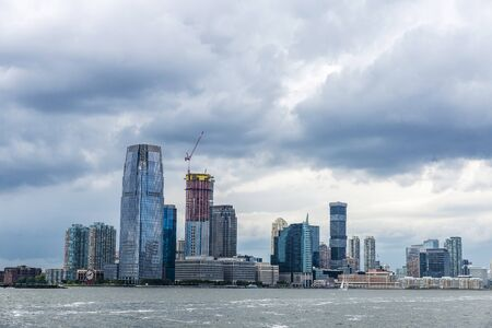 View of the skyline of modern skyscrapers of Jersey City and Colgate Center in New York City, USA