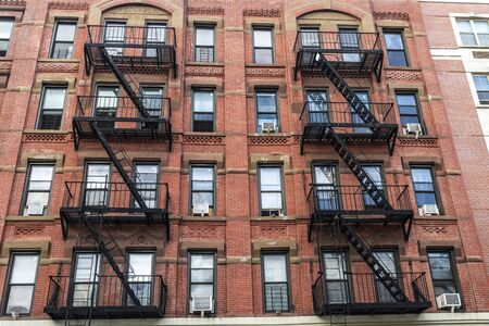 Old typical apartment buildings with its fire escape in the Harlem neighborhood in Manhattan, New York City, USA Stock Photo