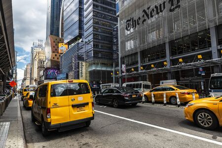 New York City, USA - August 2, 2018: Facade of The New York Times (NYT and NYTimes) headquarters with taxis on Eighth Avenue, Manhattan, New York City, USA