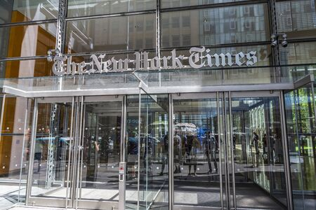 New York City, USA - August 2, 2018: Entrance of The New York Times (NYT and NYTimes) headquarters with people around on Eighth Avenue, Manhattan, New York City, USA Redakční