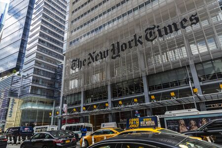 New York City, USA - August 2, 2018: Facade of The New York Times (NYT and NYTimes) headquarters with traffic and people around on Eighth Avenue, Manhattan, New York City, USA Redakční