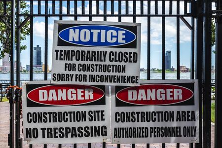 Signs of forbidden to pass and danger for construction works in New York Harbor, Manhattan, New York City, USA 写真素材