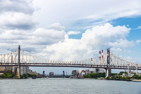 View of the Ed Koch Queensboro Bridge and Ravenswood Generating Station in New York City, USA 写真素材