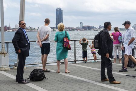 New York City, USA - August 2, 2018: People waiting on a jetty on the East River in Manhattan, New York City, USA