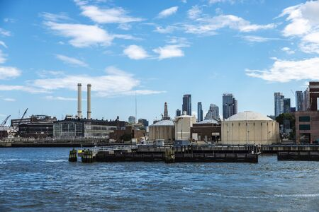 Dock with industrial factories and warehouses on the East River in New York City, USA