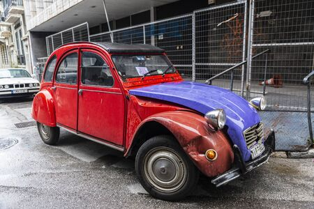Athens, Greece - December 31, 2018: Red and blue Citroen 2CV (two steam horses or two tax horsepower) car parked on a street in Athens, Greece Editorial