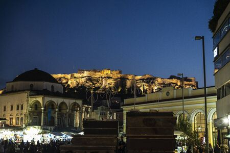 View of the Acropolis of Athens at night for Christmas with people around, Greece