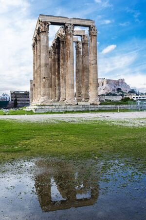 Temple of Olympian Zeus (Olympieion or Columns of the Olympian Zeus) reflected in a puddle of water in Athens, Greece