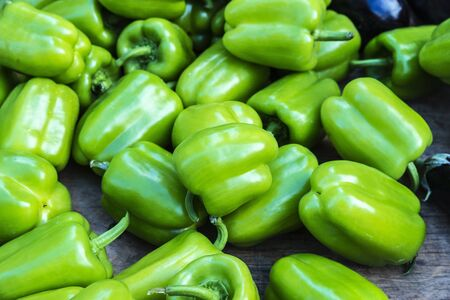 Green bell pepper (also known as sweet pepper, pepper or capsicum) stand in a farmer market on a street as background in Athens, Greece