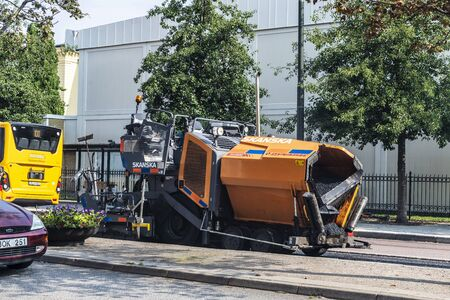 Malmö, Sweden - August 29, 2019: Asphalt machine or compactor on a street in Malmo, Sweden 報道画像