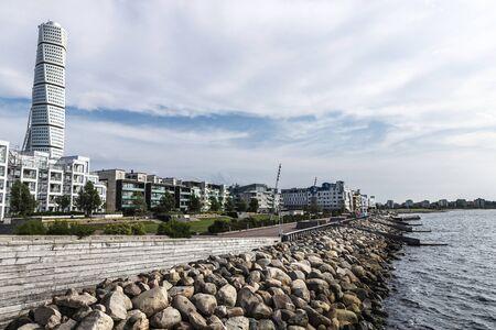 Malmö, Sweden - August 30, 2019: Turning Torso, futurist skyscraper designed by Santiago Calatrava Street with modern residential buildings and the promenade by the sea in Västra Hamnen, Malmo, Sweden Archivio Fotografico