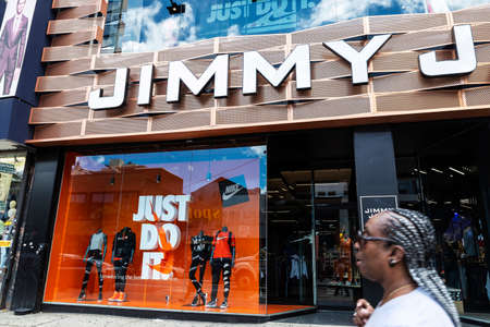 New York City, USA - August 4, 2018: Facade of the Jimmy Jazz sports store with a black woman around and the phrase Just do it of the Nike brand in Harlem, Manhattan, New York City, USA Editorial