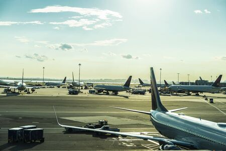 Airplanes parked in a row at John F. Kennedy International Airport (JFK Airport, JFK or Kennedy) in Queens, New York City, USA
