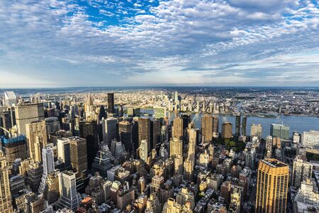 Elevated view of the skyline of modern skyscrapers of Manhattan at sunset in New York City, USA Stockfoto