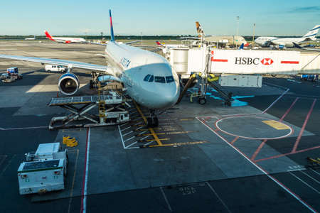 New York City, USA - August 4, 2018: Delta Air LInes airplane with a finger with HSBC advertising parked at John F. Kennedy International Airport (JFK Airport, JFK or Kennedy) in Queens, New York City, USA
