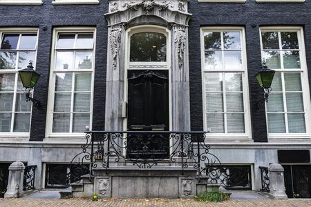 Classic doorway of an old traditional leaning house in the old town of Amsterdam, Netherlands