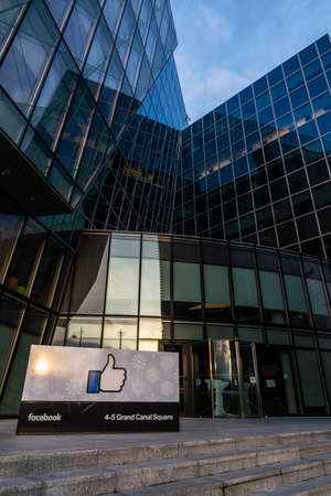 Dublin, Ireland - January 1, 2020: Logo of Facebook headquarters with a sunbeam, office building in Grand Canal Square, Dublin, Ireland Editorial