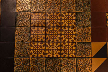 Tiled floor decorated with symmetrical geometric shapes and the fleur-de-lis in the interior of the Saint Patrick's Cathedral in Dublin, Ireland