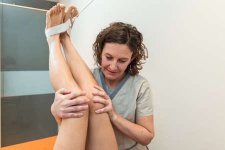 physiotherapist with patient, Coxofemoral angle closure posture to stretch
