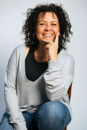 Studio portrait of a middle-aged smiling woman 写真素材