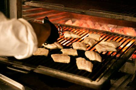 Chef cooking fish on a babacue