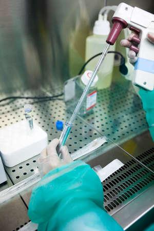 Scientific manipulating a test tube in a laboratory