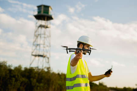 Drone operator piloting a Drone on A Rural Setting