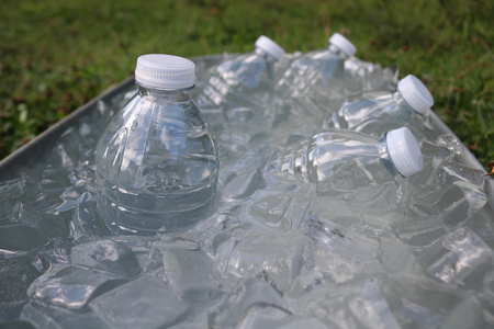 ice water: Water bottles in ice tub.