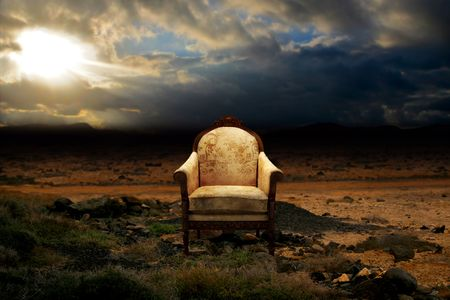 A ruined throne abandoned in rock desert