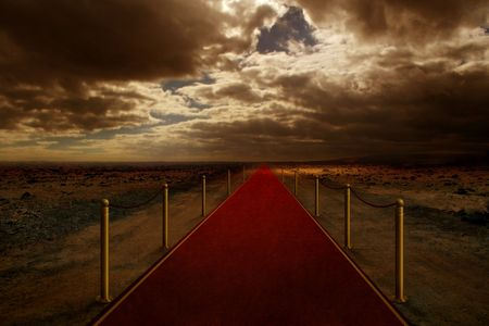 Red carpet on road of desert Stock Photo