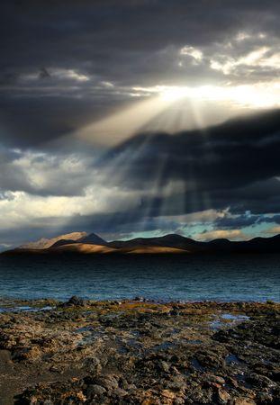 Landscape . The sun's rays break the dark clouds Stock Photo - 4485979
