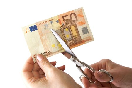 The female hand cuts the banknote with scissors Stock Photo