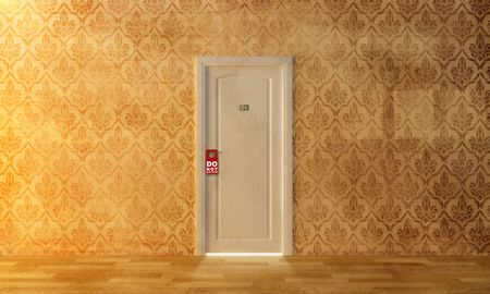 hotel room door: a white door on the damask wall with  Stock Photo