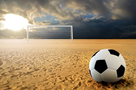 Soccer ball on penalty disk in sand beach Stock Photo - 6848318