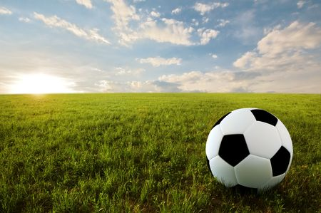 Soccer ball on meadow in sunset time Stock Photo - 6848319
