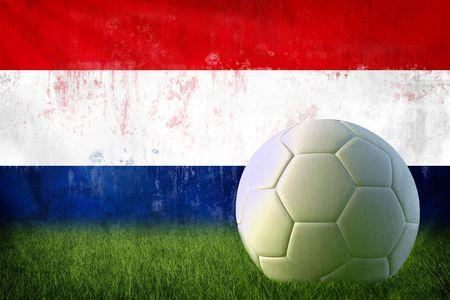 Grunge Netherland flag on wall and soccer ball photo